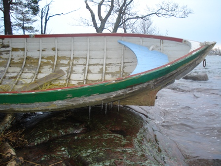 Wooden boat in ice
