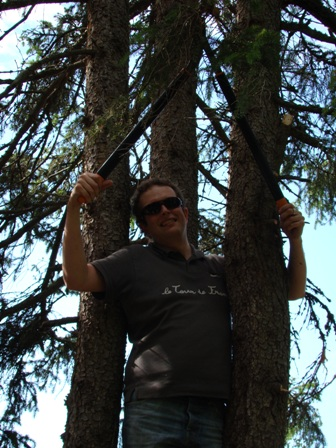 Me, climbing a spruce to cut lowhanging branches
